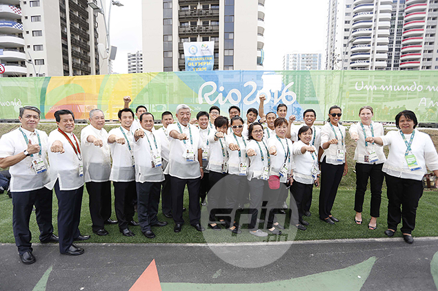 The Philippine Olympic delegates in high spirits before the flag-raising ceremony.