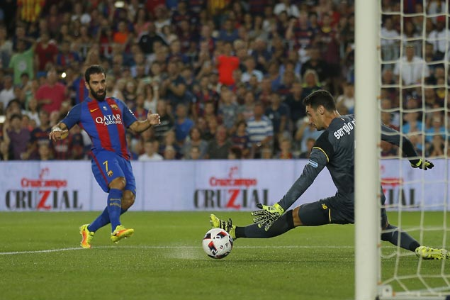 Barca beats Sevilla 3-0 to win Spanish Super Cup