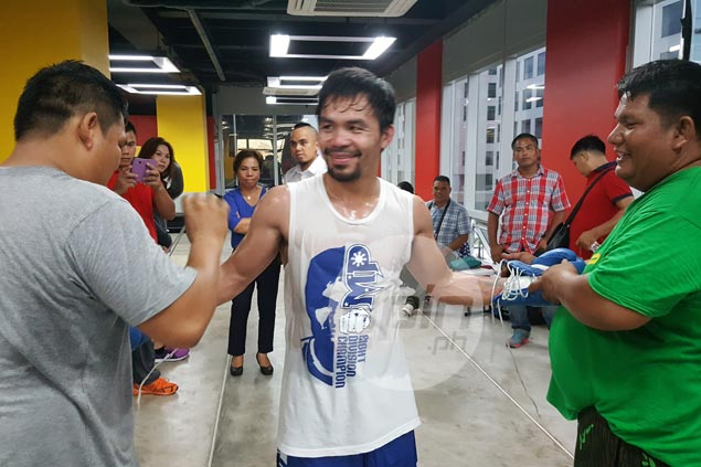 Pacquiao never too tired for boxing training, hoops after tension-filled Senate hearing