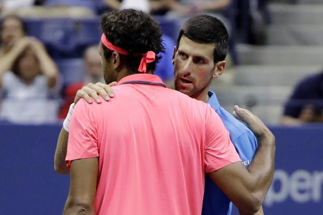 US Open: Novak Djokovic through to semi-finals after Tsonga retirement
