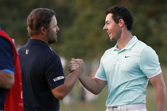Ryan Moore bows to Rory McIlroy after four playoff holes at East Lake ...