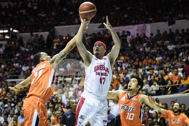Mark Caguioa evades the long arms of Newsome for the floater.