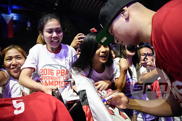 Caguioa signs a fan's shirt.