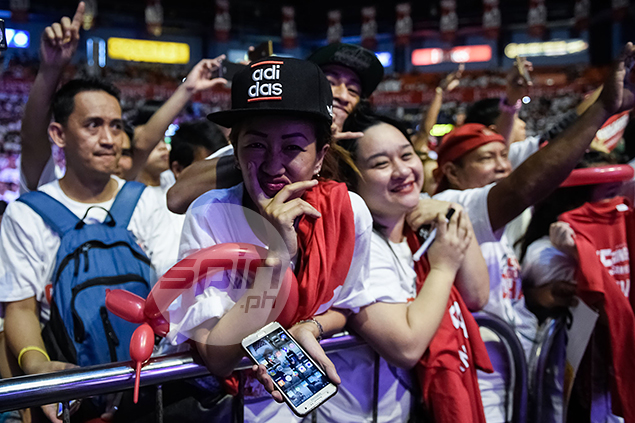A lucky fan receives JayJay Helterbrand's adidas hat.