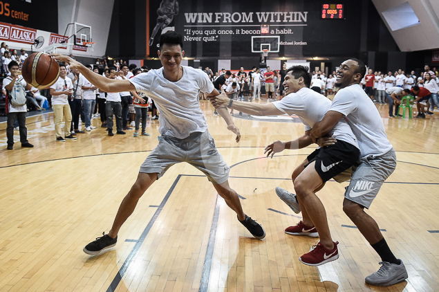 Dondon Hontiveros and Calvin Abueva get clingy in one of the games during Alaska's fans day on Friday at the Gatorade Hoops Center.