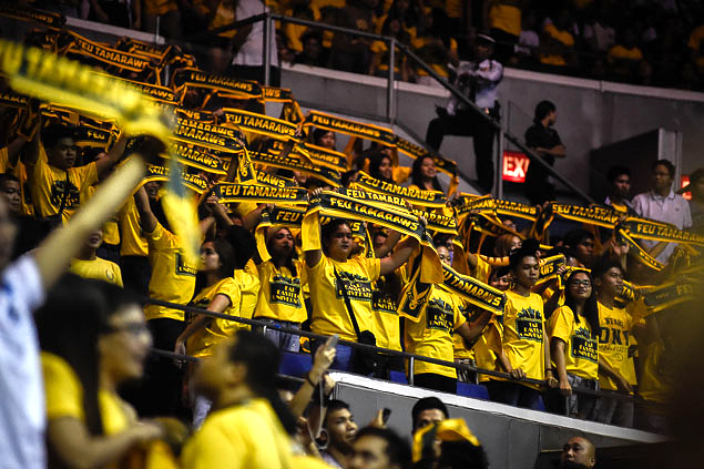 FEU crowd cheers for its cheerdance squad.