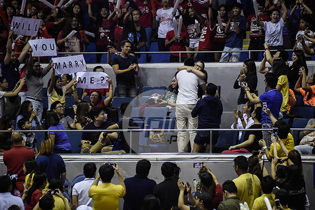 A marriage proposal in the crowd earns a piece of the limelight.