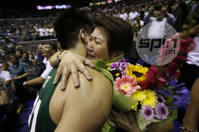 Teng heads straight to his mom, Susan.