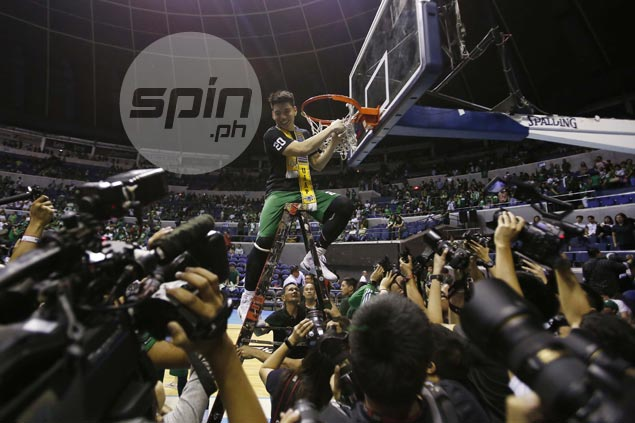 The man of the match, Jeron Teng, gets the honor of cutting down the net.