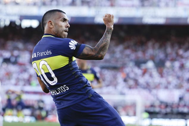Argentine striker Carlos Tevez joins China's Shanghai Shenhua for a hefty fee