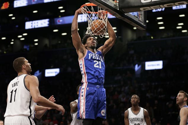 Sluggish Sixers beat Nets in matinee