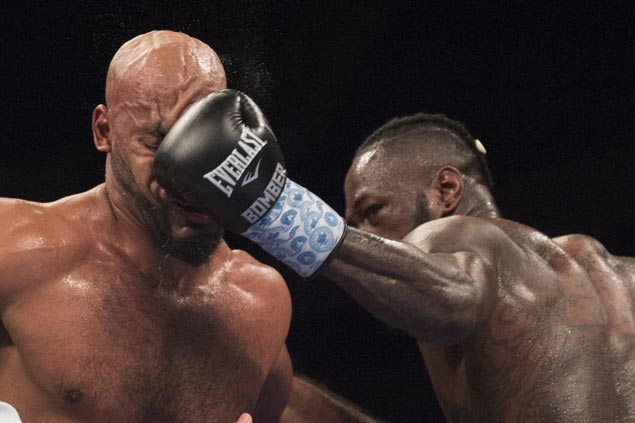 Deontay Wilder retains WBC title with fifth-round KO of Washington