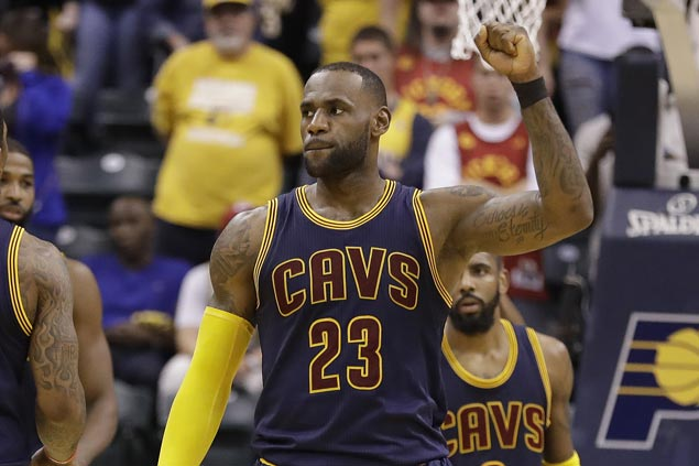 LeBron James highlights milestone night with go-ahead triple as Cavs eliminate Pacers