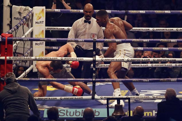 Anthony Joshua recovers from first knockdown of career to stop Vladimir Klitschko in 11th round