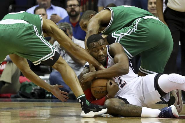 Angry Wizards player ejected after bulldozing Celtic
