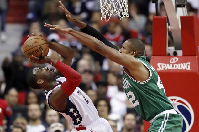 John Wall and the Wizards hope to finally win on the road against the Celtics this season
