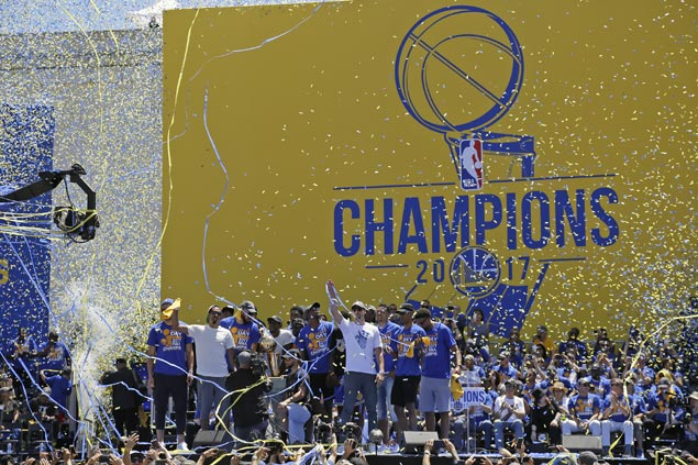 Warriors savor return to NBA throne with grand championship parade through Oakland