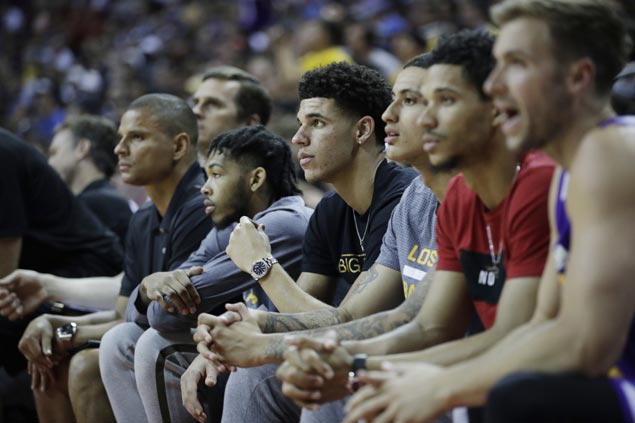Lonzo Ball exits early with calf injury but Lakers hold off Mavs to reach Summer League finals