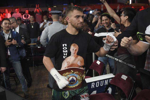 Lomachenko defends belt, stops Marriaga after 7 rounds