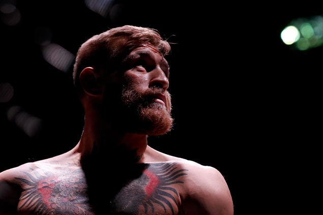 With eight-ounce gloves, McGregor convinced he can KO Mayweather in two rounds