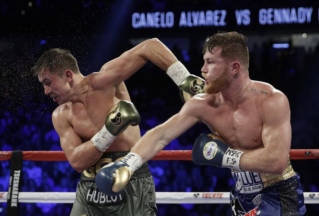 Gennady Golovkin retains middleweight titles after brutal draw with Canelo Alvarez