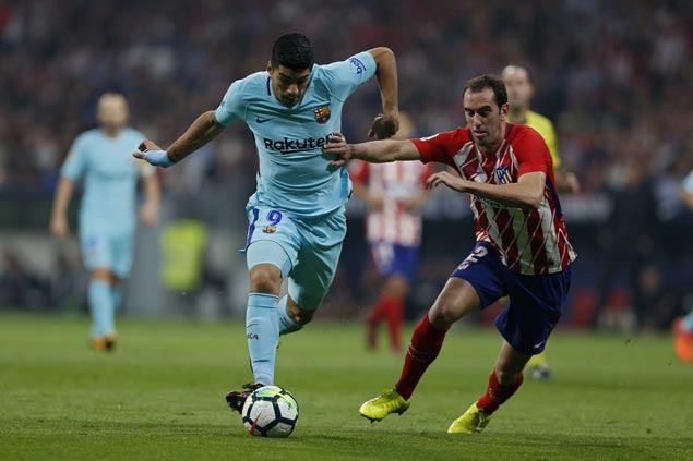Messi contained but Suarez scores as Barca salvages draw to extend unbeaten run against Atletico
