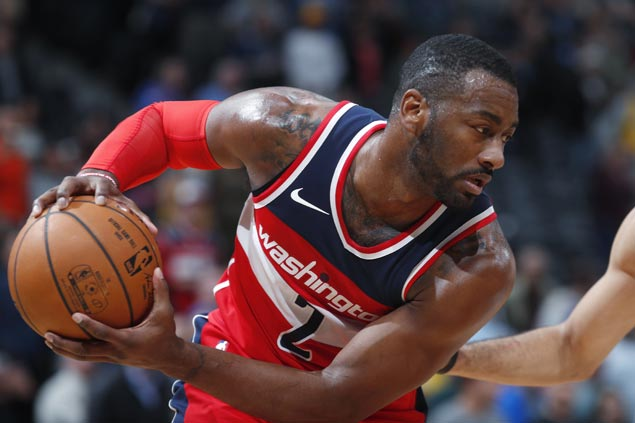 Wizards open road swing with win over Nuggets