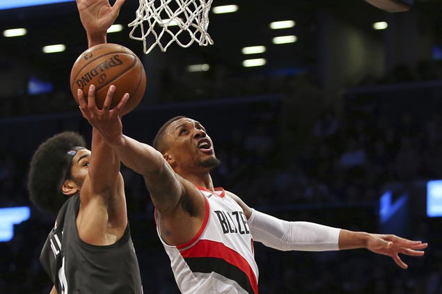 Trail Blazers scrape past Nets in matinee thriller