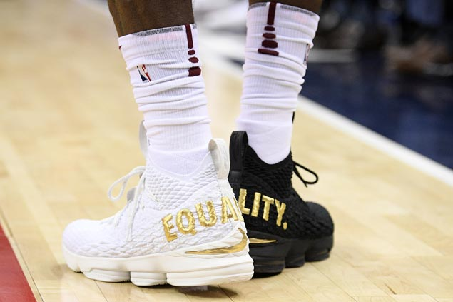 LeBron James makes statement on equality with one black shoe, one white shoe