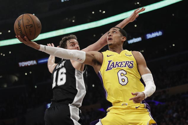 Lakers blow 19-point lead but recover with late blitz to hold off Spurs for third win in a row