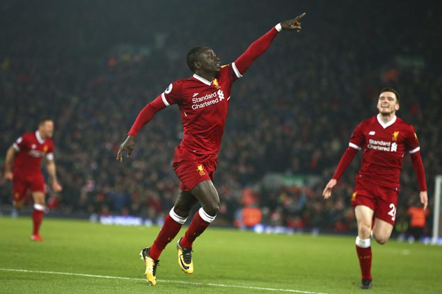 Liverpool scores three goals in nine minutes, survives nervy finish to end City's 22-match unbeaten run