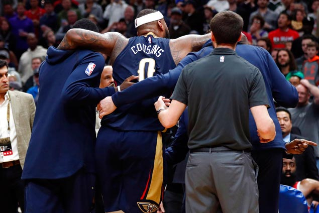 d692cf85a DeMarcus Cousins is helped off the court after suffering the injury. AP