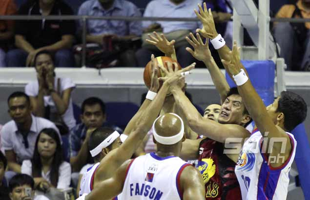 B-Meg star James Yap tries to put up a shot against four Petron defenders. Photo by Jerome Ascano