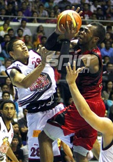 B-Meg import Marcus Blakely drives hard to the basket against Willie Wilson. Photo by Jomar Galvez