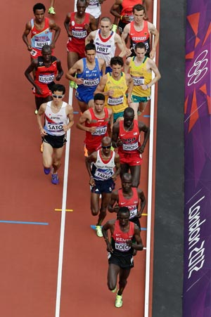 Isiah Kiplangat Koech takes the early lead and winds up second in heat two. AP