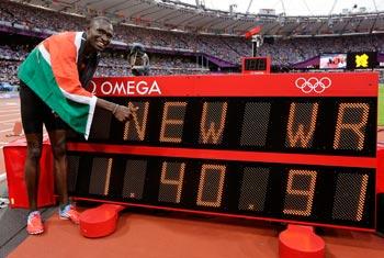 Kenya's David Lekuta Rudisha poses next to a timing board displaying his new world record after the men's 800-meter final. AP