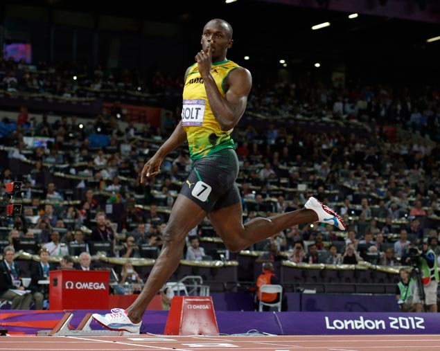 Usain Bolt cruises to gold in the men's 200-meter final, the second of his three victories in London. The fastest man in the world also won the century dash and anchored the Jamaican team to victory in the 4x100-m relay. AP