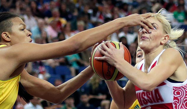 Australia's Elizabeth Cambage jams her finger into the eye of Russia's Natalya Vodopyanova while defending a drive to the basket during the women's bronze medal basketball game. The Aussies won 83-74. AP