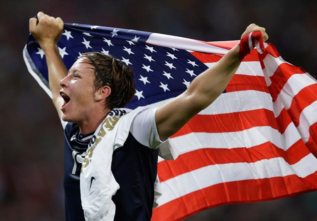 United States' Abby Wambach celebrates after winning the women's football title match against Japan. The 2-1 win gave the Americans their third straight Olympic gold. AP
