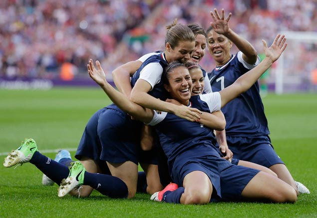 United States football players celebrate after scoring during the women's football gold medal match against Japan. AP