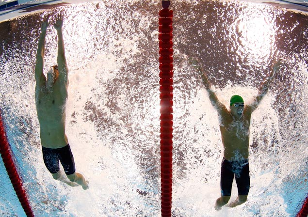 United States' Michael Phelps (left) touches the wall as South Africa's Chad le Clos closes in for second place during the men's 100-meter butterfly final. AP