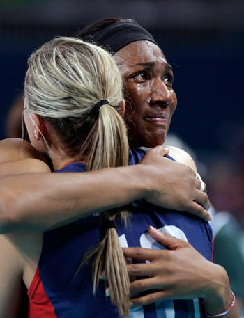 USA's Foluke Akinradewo can't hold back the tears as she hugs teammate Jordan Larson after losing to Brazil in four sets in the women's volleyball gold medal match. AP