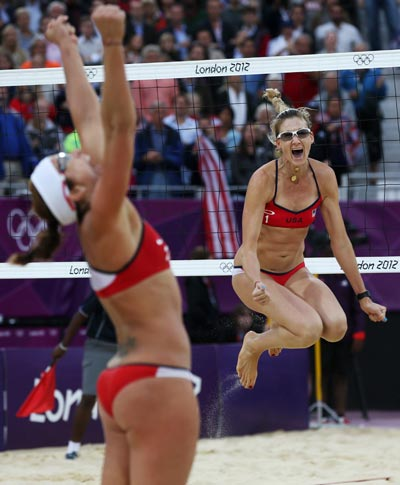 United States' Misty May-Treanor (left) and Kerri Walsh Jennings celebrate after defeating China in their semifinal women's beach volleyball match, en route to their third consecutive Olympic gold. AP