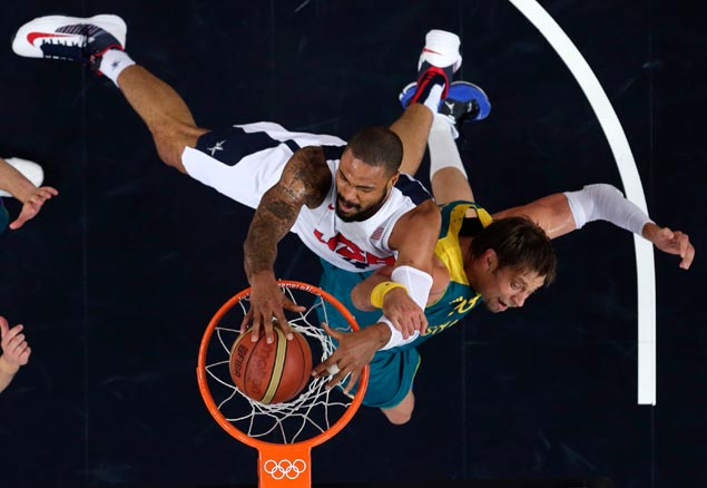 USA's Tyson Chandler dunks against Australia's David Andersen during a men's quarterfinals basketball game. AP