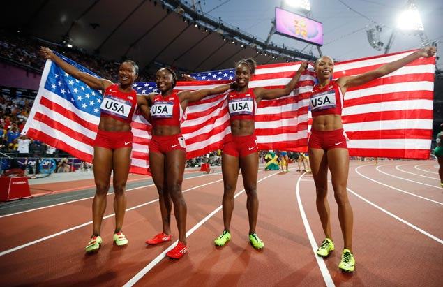 The US women's 4x100-meter relay team of Carmelita Jeter (from left), Bianca Knight, Tianna Madison and Allyson Felix celebrate winning gold and setting a new world record 40.82 seconds. AP