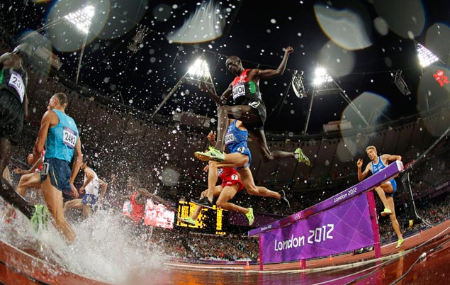 Kenya's Ezekiel Kemboi stays behind the pack in the early goings but goes on to win the men's 3000-meter steeplechase final. AP