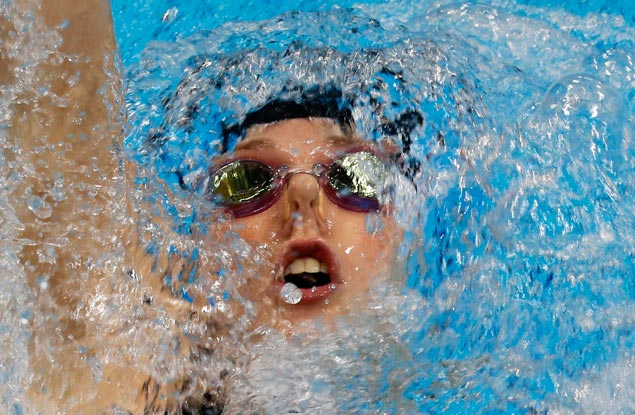 Seventeen-year-old American Missy Franklin sets a new world record time of two minutes and 4.06 seconds in winning the women's 200-meter backstroke title. AP