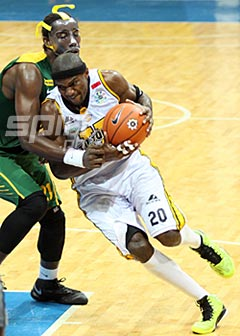 Karim Abdul of UST tries to muscle his way inside against FEU's Christian Sentcheu. Photo by Jerome Ascano