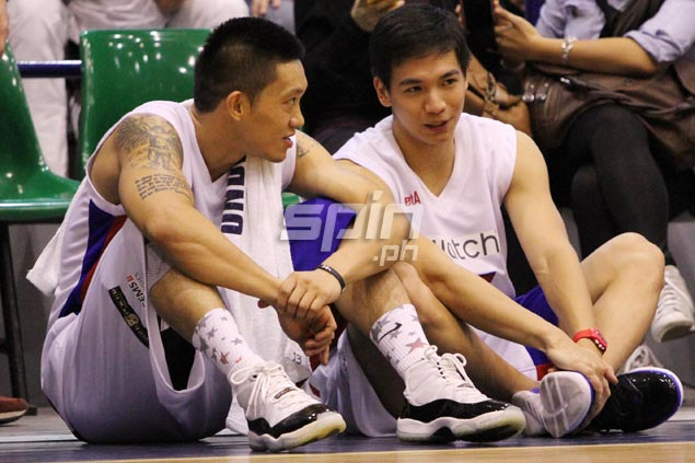 Rain or Shine rookie Chris Tiu, pictured right with Ginebra's Jayjay ...