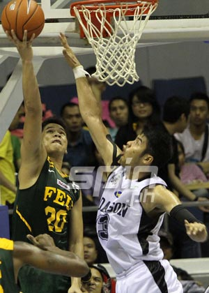 FEU's Roger Pogoy rises for a shot over Adamson's Eric Camson. Photo by Jerome Ascano